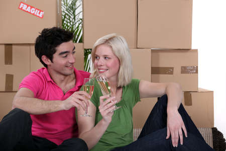 Couple having a celebratory drink on moving day photo