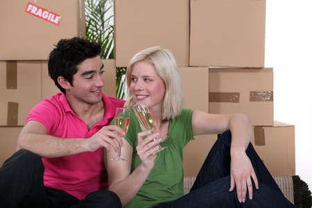 effervescence: Couple having a celebratory drink on moving day