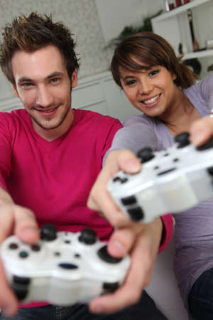 gamer: Couple playing a games console