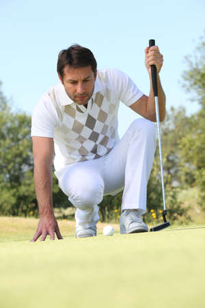 Golfer putting photo