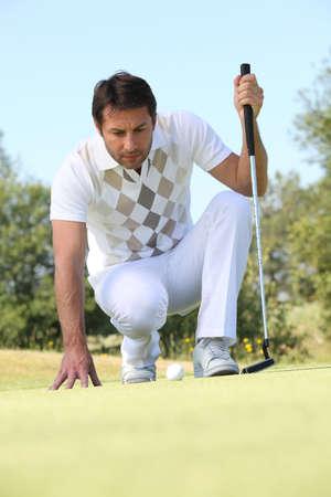 Golfer putting photo