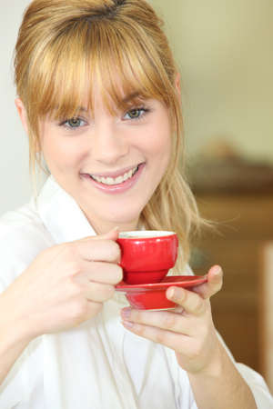 bubbly: Woman drinking a cup of coffee Stock Photo