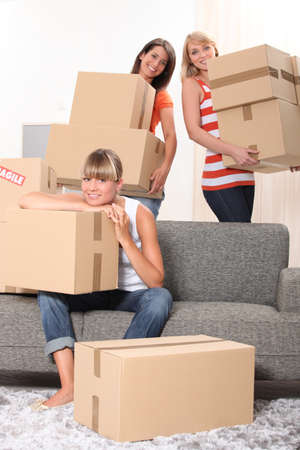 17 19 years: Girls carrying boxes Stock Photo