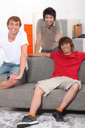 roommates: Housemates relaxing together in their sitting room
