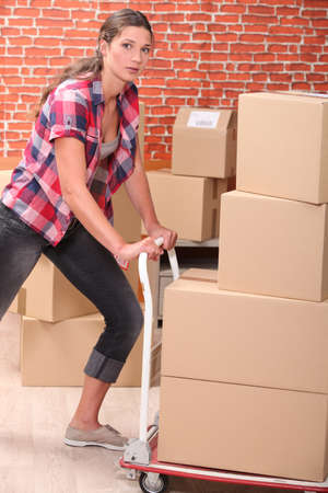 portrait of a woman with moving boxes photo