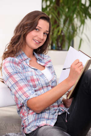 Young woman writing photo
