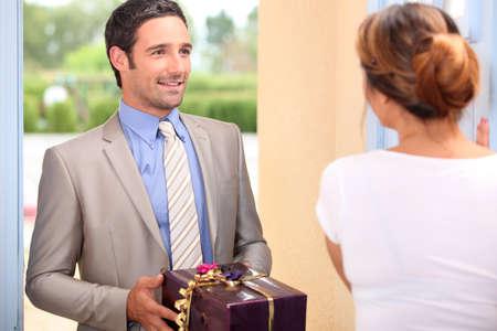 Boyfriend delivering girlfriend present photo