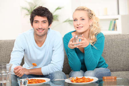 Young couple having meal at home photo