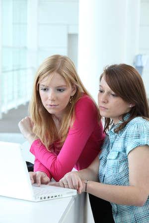 peer to peer: Girls using a laptop computer