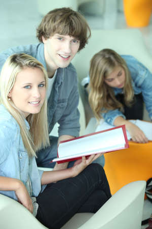 Students in a common room discussing an assignment photo