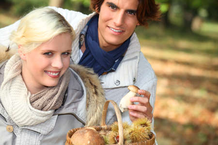 Couple collecting chestnuts photo