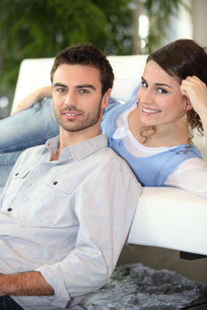 young couple on sofa photo
