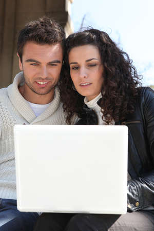 captivate: Couple looking at their laptop
