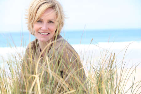 woman 40 years: Woman in the sand dunes