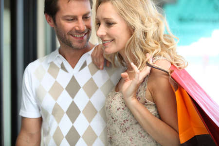 30 34 years: Couple on a happy shopping trip Stock Photo