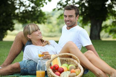 barefoot man: Couple enjoying picnic Stock Photo