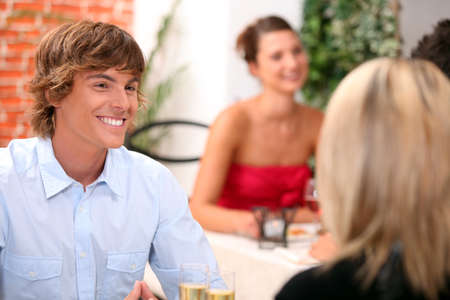 eat out: Young man on a date in a restaurant