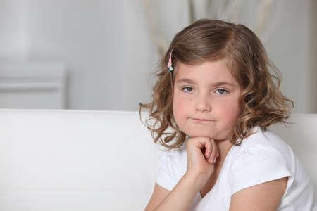 discontented: Grumpy little girl