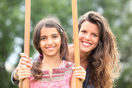 Mother with a daughter on stilts Stock Photo - 11132570