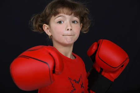 girl punch: little girl boxing Stock Photo