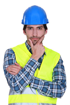 purposely: Tradesman staring intently at the camera