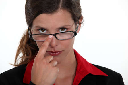 A businesswoman repositioning her glasses. photo