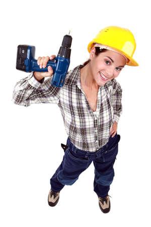 high torque: Tradeswoman holding a power tool Stock Photo