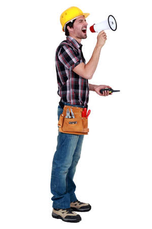 craftsman holding a walkie talkie and shouting through a megaphone photo