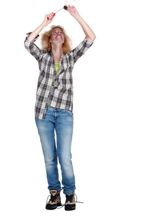 unprofessional: Electrocuted woman mending a ceiling light