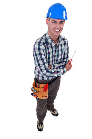odd jobs: Man with a screwdriver Stock Photo