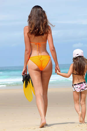 bikini island: a mother and  her daughter on the beach
