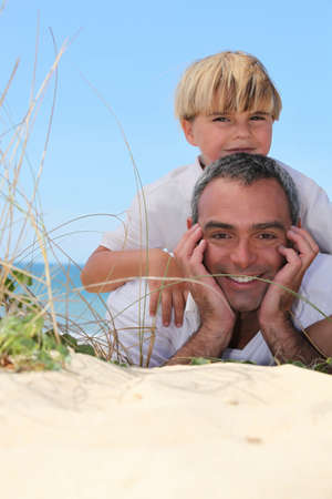 rugged: Father and son at the beach