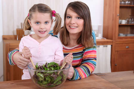 mother and daughter preparing a salad Stock Photo - 11124435