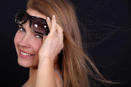 breezy: Woman wearing sunglasses on a breezy day