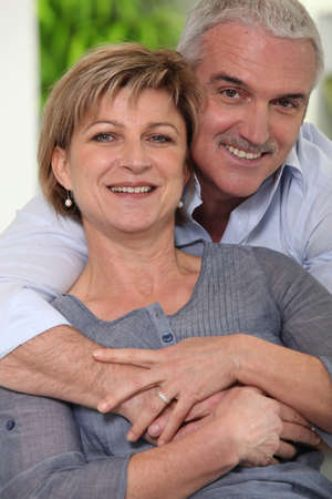 couples hug: Mature married couple in a loving embrace