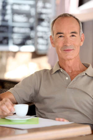 55 59 years: Senior man drinking a cup of expresso Stock Photo