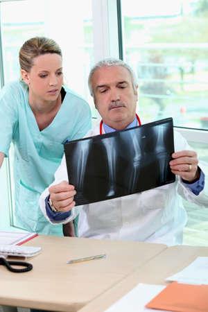 Doctor and nurse examining an xray photo