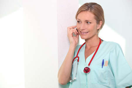 Female nurse on mobile telephone Stock Photo - 11124488