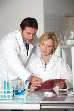 co work: A man and a woman working in a lab. Stock Photo
