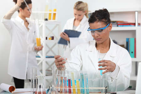 deduct: Women conducting an experiment Stock Photo