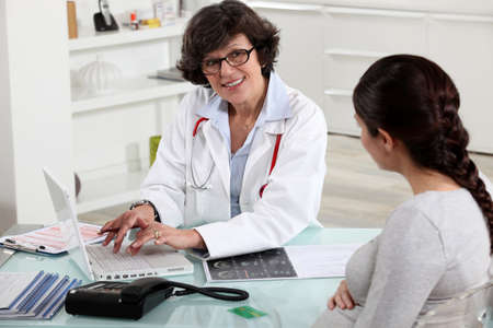 pregnant woman visiting her doctor Stock Photo - 11132287