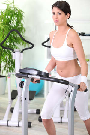 young woman training on a treadmill in the gym photo