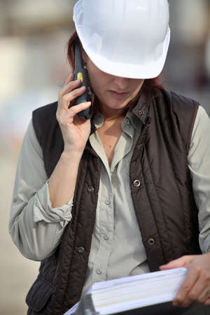 Female foreman with radio receiver photo