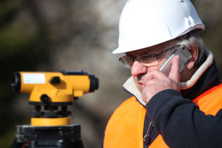 civil engineer: Civil engineer with surveying equipment