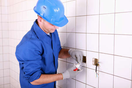 building maintenance: electrician working