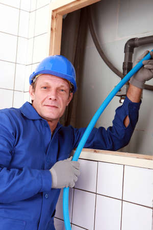 air duct: close shot of plumber Stock Photo