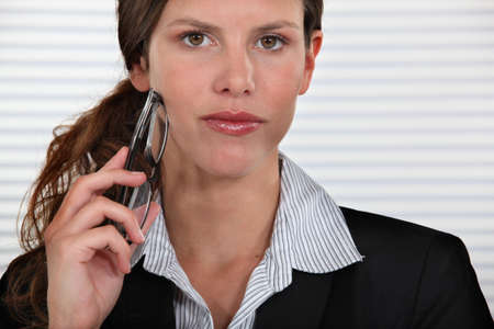 tantalizing: Woman holding glasses to face Stock Photo
