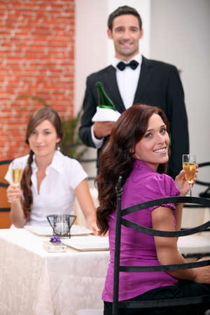 Waiter serving customers photo
