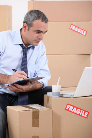 relocating: Man searching for new furniture on the internet Stock Photo