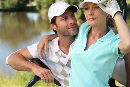 gloves women: Golfer couple Stock Photo